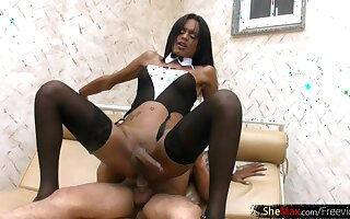 Ebony chick with huge shecock fucks her guy