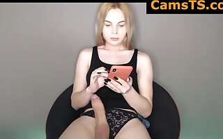 Beautiful Russian Shemale Regarding Chunky Breasts Added to Dildo