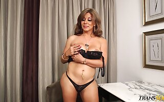Flirty transsexual MILF with muted curves jerks off to a powerful culminate