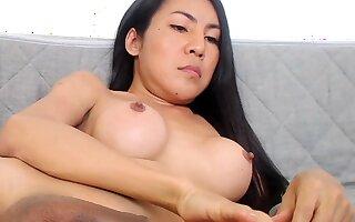 Amateur Asian shemale masturbates to orgasm